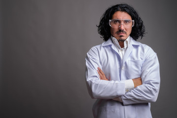 Scientist man doctor with mustache wearing protective glasses