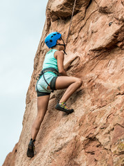 A girl doing rock climbing
