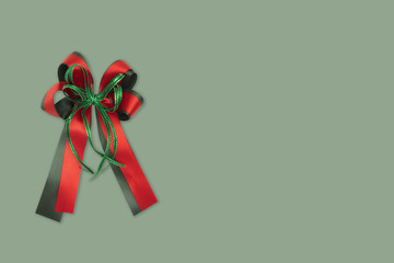 green and red gift bow for christmas holliday