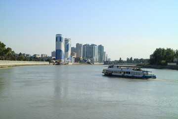 steamer in a big city. Embankment of the river in the city. Walk on the boat.