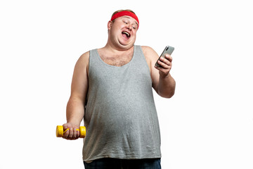 Happy overweight man planning to go in for sports, shows thums up and looking at camera with happy face, motivates to healthy lifestyle and sport