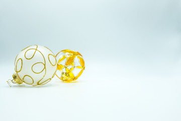 Transparent and white Christmas decoration balls with orange and golden details.