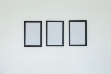 Empty frame on white wall