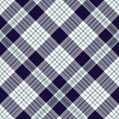 Plaid pattern in indigo, greenish blue and white. Seamless fabric texture.