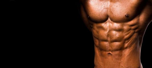 Muscular shape male torso on black background.