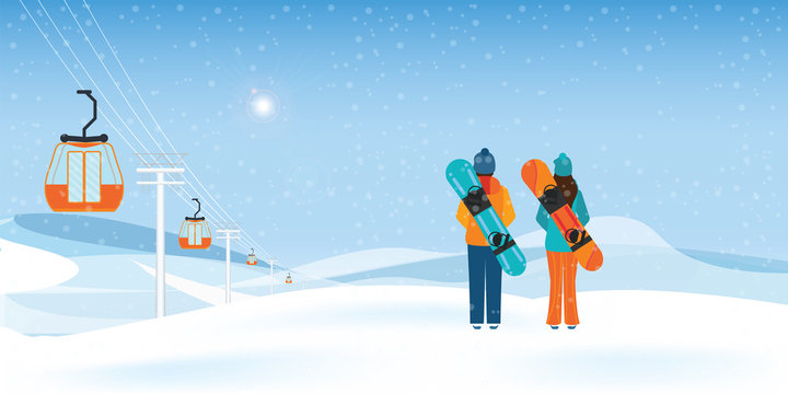Couple Snowboarders standing with snowboards.