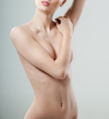Foto op Canvas Akt Beautiful young woman with clean skin nude topless breasts. Beautiful woman covering her nude breast.