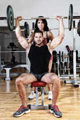 Young couple exercising in gym