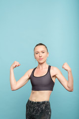 fit slim and strong woman in sportswear. female power training and health.