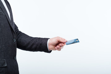 credit card online operations and banking. money transaction. man holding plastic card.