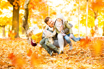 family time in sunny autumn landscape