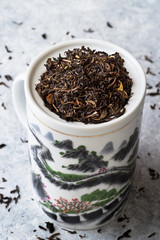 Tea and teacup with 'Great wall' design on delicate grey background