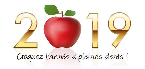 Carte de vœux pour le nouvel an 2019 montrant une pomme rouge, symbole de désir et de motivation pour croquer la vie à pleine dents