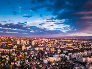 Tuinposter Luchtfoto Beautiful drone shot of a vivid sunrise over Sofia, Bulgaria - impressive image with colourful skies and amazing aerial views over the city.