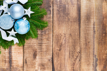 Christmas greeting card wooden background.