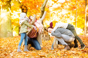 family in sunny autumn landscape