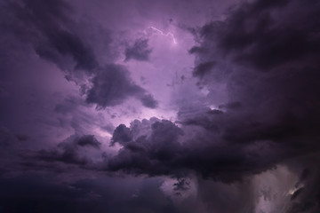 Lightning and rain clouds at night