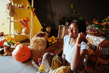 African american girl against autumn mood decoration. Fall in Africa.