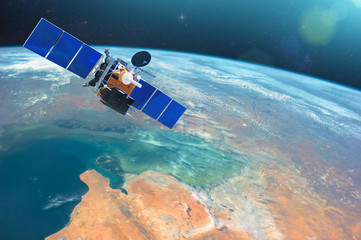 Space communications satellite in low orbit around the Earth. Elements of this image furnished by NASA.