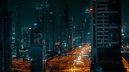 Night panorama of a large modern city, tall buildings and city highway