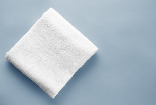 Clean soft towel on color background