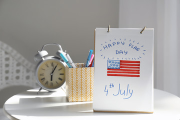 Sheet of paper with drawing of American national flag on white table