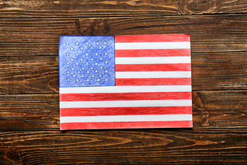 Drawing of American national flag on wooden table
