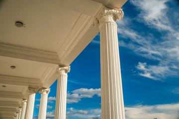 Columns on blue sky background.