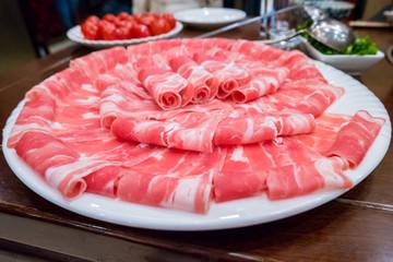 Hotpot beef rolls closeup on plate