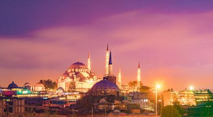 Night view to Suleymaniye Cami, from Galata Bridge, Istanbul, Turkey.