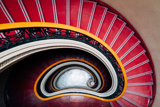 Spiral red downward staircase