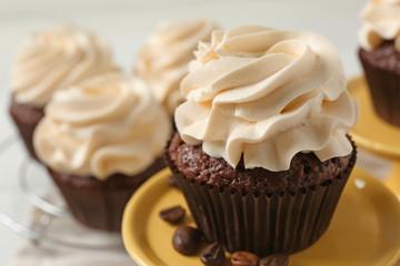 Tasty chocolate cupcake on dessert stand, closeup