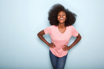 Portrait of confident young black woman smiling Wirth hands on hips