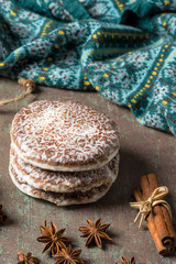 Lebkuchen, typical spicy Christmas cookies of German origin, especially Nuremberg, on rustic background.