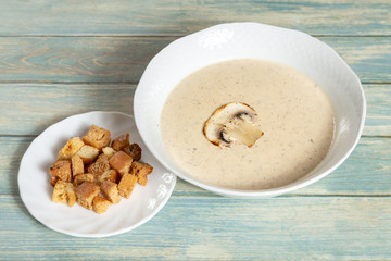 Plate of mushroom cream soup with croutons