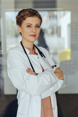 Portrait of a confident female doctor, with arms crossed