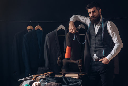 Perfect design. business dress code. Handmade. retro and modern tailoring workshop. suit store and fashion showroom. sewing mechanization. Bearded man tailor sewing jacket. Another client