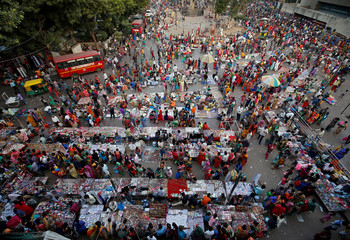 Shoppers crowd at a market place ahead of the Hindu festival of Diwali in Ahmedabad