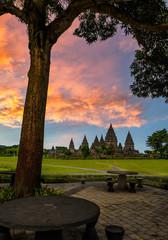 Prambanan temple beautiful garden with cloud sunset sky background