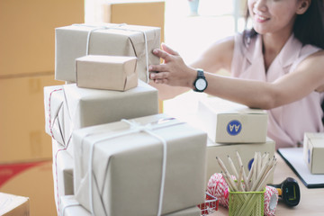 Asian women business owners work at home office of the packaging. Shopping online entrepreneurs SME or freelance concept.