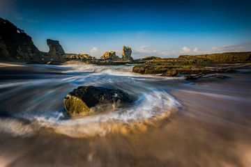 Beautiful sea wave of Klayar beach in long exposure. Location Pacitan, East Java, Indonesia