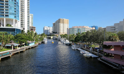 Skyline aerial view of downtown Fort Lauderdale   New River Waterways. Yachts and boats dock along the New River and next to Riverwalk a lush tropical riverfront park.