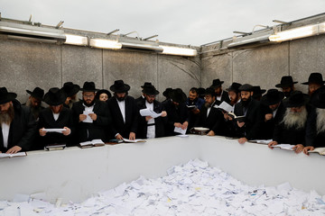 Chabad-Lubavitch rabbis pray at the gravesite of fellow late Rabbi Schneerson in New York