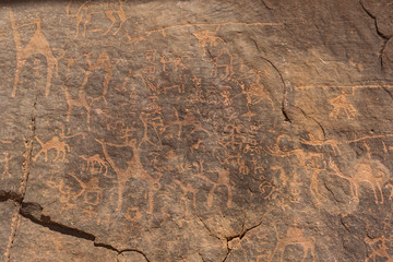 Prehistoric rock painting in the red sand desert Wadi Rum, Jordan.