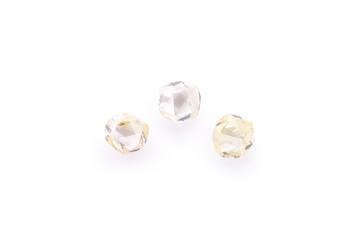 three faceted natural transparent diamonds in macro