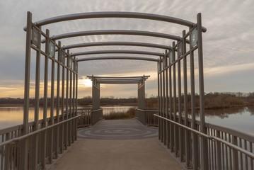 Bridge at sunset on the boardwalk over Purgatory Creek