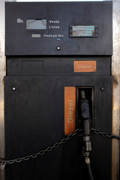 A nozzle diesel fuel is seen locked with a chain in a dispenser at a gas station of the Venezuelan state-owned oil company PDVSA in Caracas