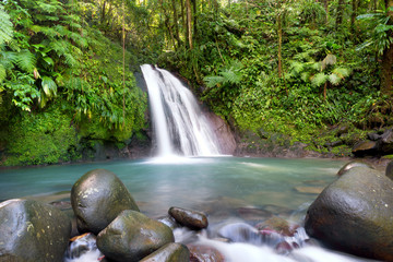 "Most famous touristic site in Guadeloupe, french west indies, ""cascade aux ecrevisses"" (crawfishes waterfall)."
