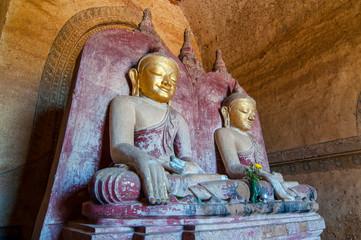 Bagan Twin ancient Buddha images in Dhammayangyi temple of Bagan, Mandalay, Myanmar.