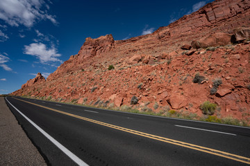 American road through the orange red mountains. empty street highway. on way from grand canyon to page arizona usa. climb mountain road. United states steep gradient streets. uphill path to the goal